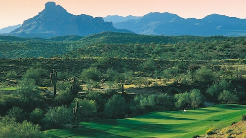 Beautiful landscape view of golf course with mountains in the distance.