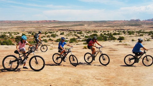 group riding bikes in the bright sun in Green River