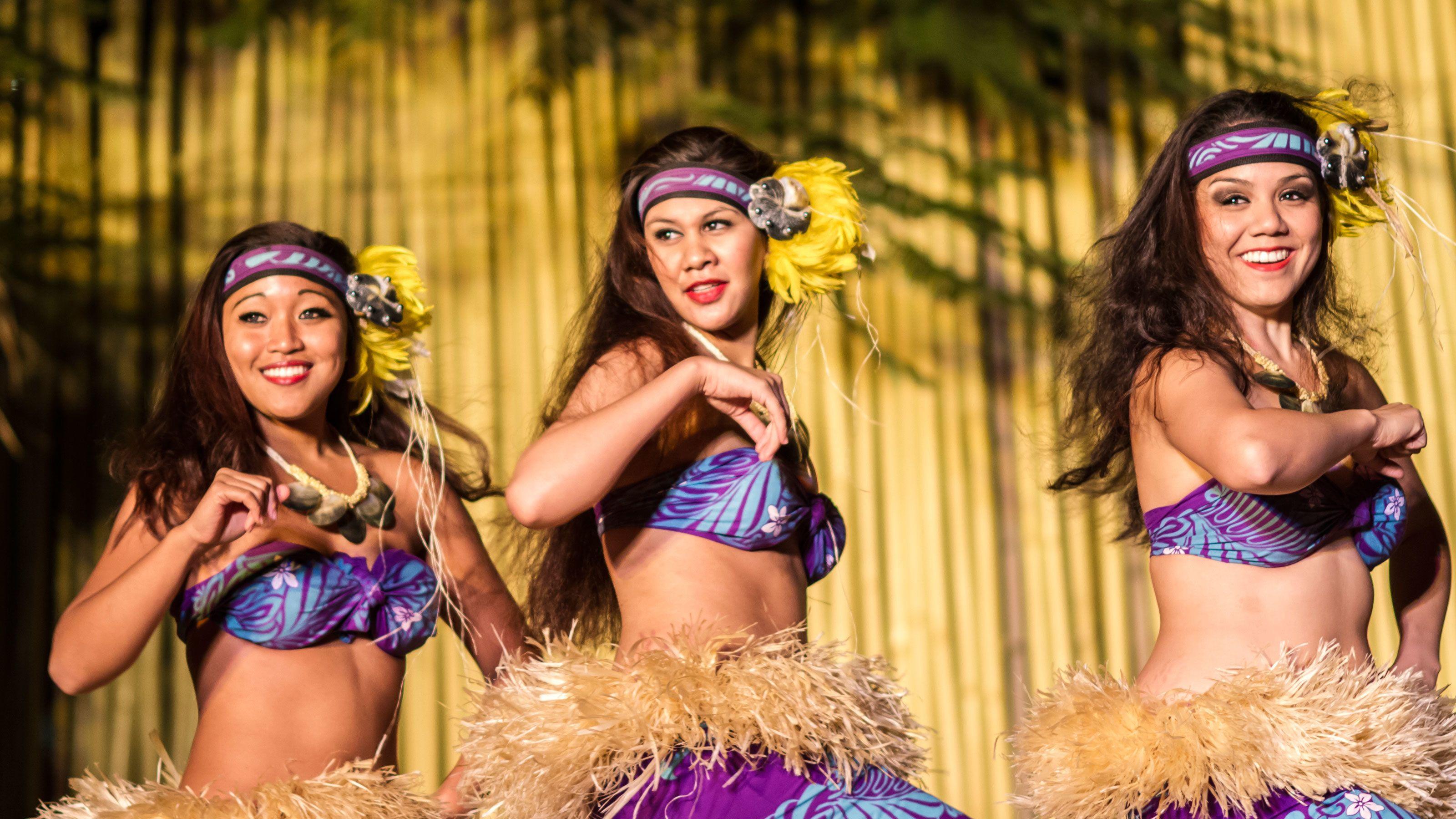 Three women dancing at the Luau at Royal Lahaina Resort in Maui