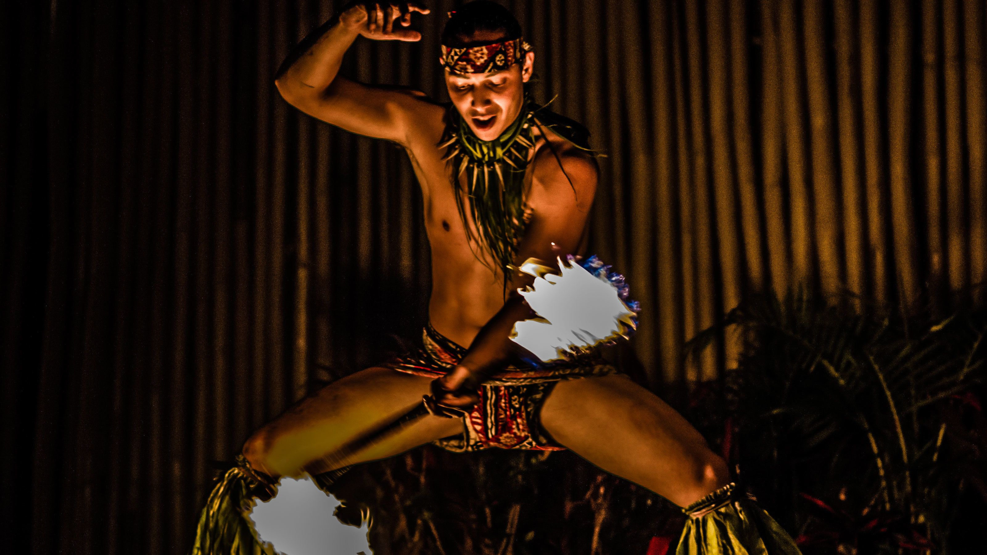 Male performer fire dancing at the Luau at Royal Lahaina Resort in Maui