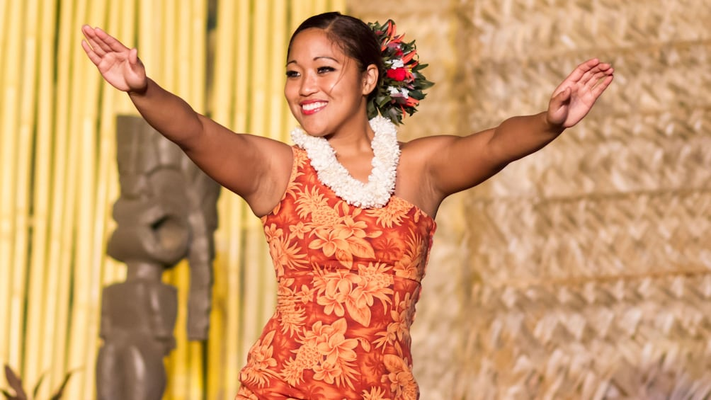 Show item 5 of 10. Woman dancing at the Luau at Royal Lahaina Resort in Maui