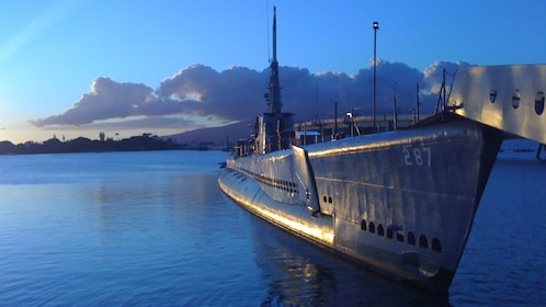 USS Bowfin docked in the peaceful waters of Pearl Harbor, Oahu