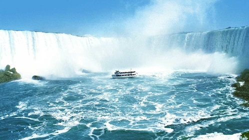 passenger boat close to the waterfall in Niagara