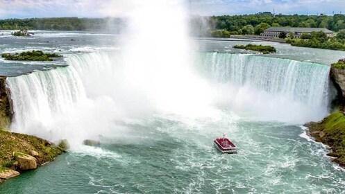 waterfall spraying mist near the boat in Niagara