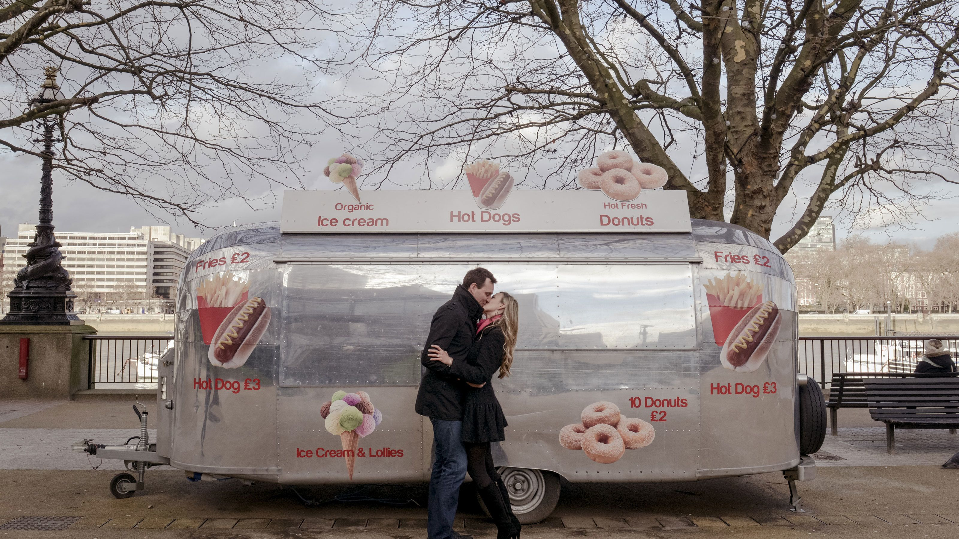 Couple kissing in front of a food truck in London