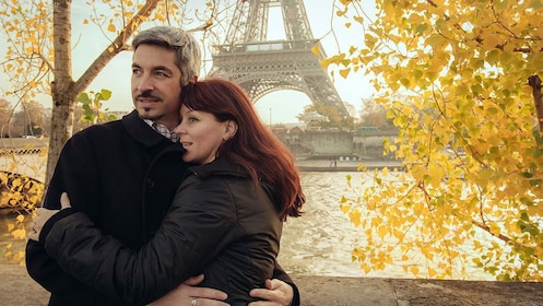 Portrait of a couple with the Seine river and Eiffel tower behind them in Paris