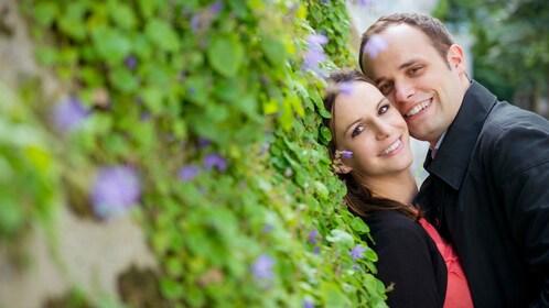 Couple posing in a garden in Monaco