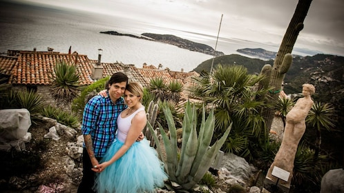 Couple posing at a scenic lookout overlooking the coast in Monaco