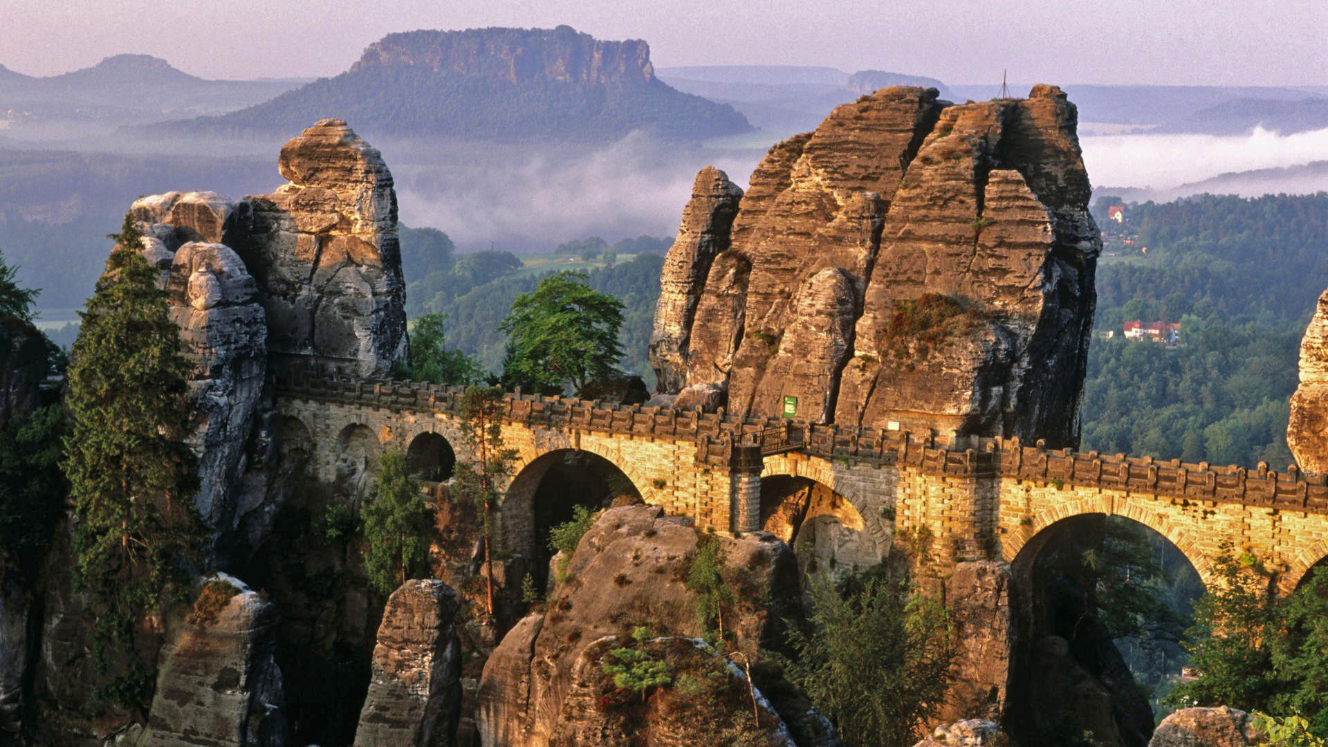 bridge through rock formations