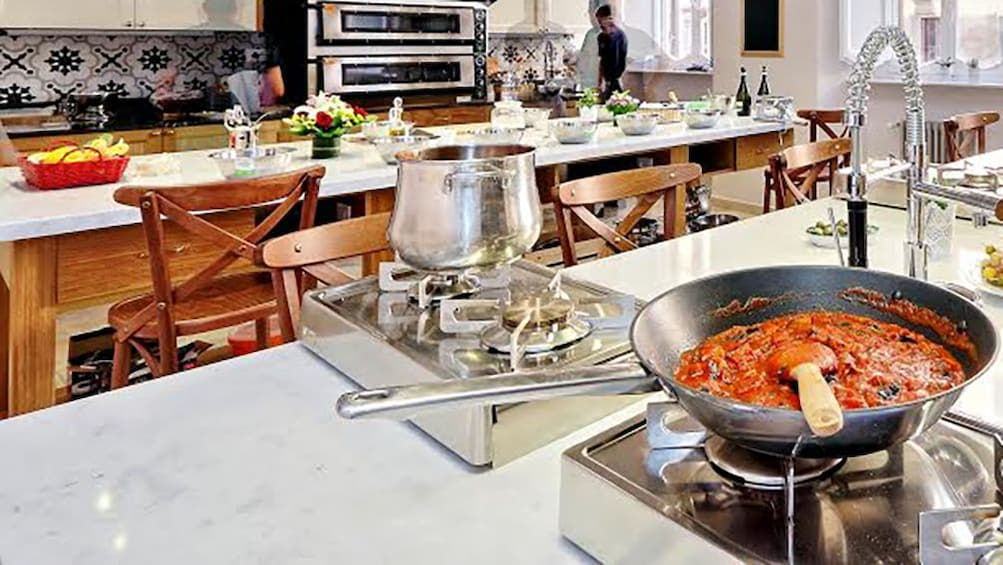 Show item 2 of 5. Cooking class kitchen with pots