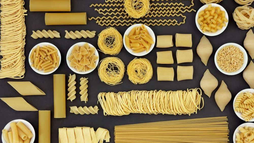 Multiple types of pasta arranged in an artistic display