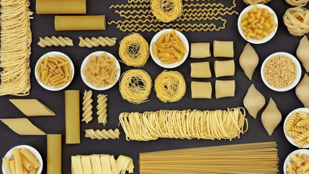 Charger l'élément 4 sur 5. Multiple types of pasta arranged in an artistic display