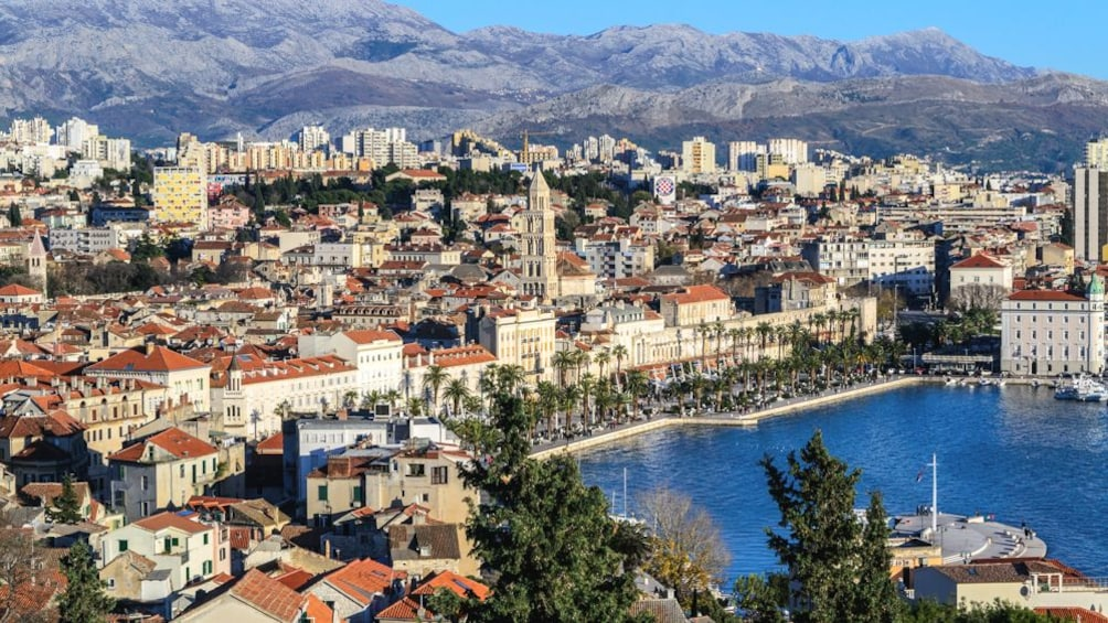 Show item 1 of 6. Beautiful aerial view of Split with several buildings and mountains in the distance.