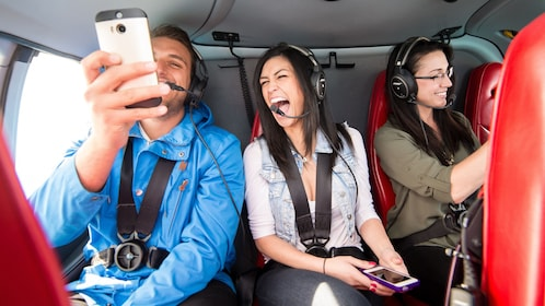 Tourists take a selfie on a Helicopter tour