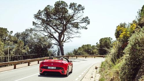 Ferrari traveling down road in Barcelona