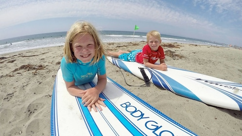 Children having fun on the group surf lesson in Los Angeles, CA