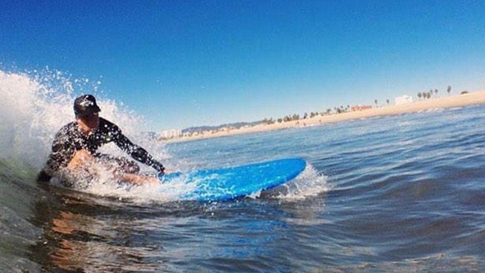 Surfer rides a wave