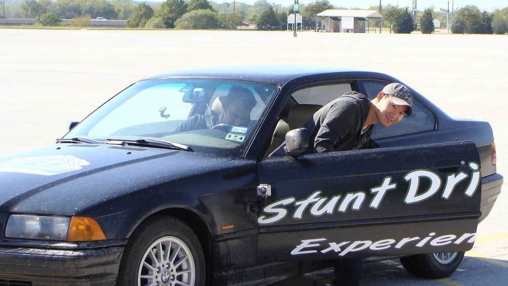 Show item 3 of 5. stunt driver getting out of the car in Ontario