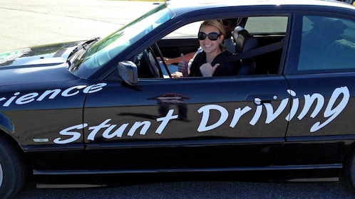 woman ready to take the wheel of a stunt car in Ontario