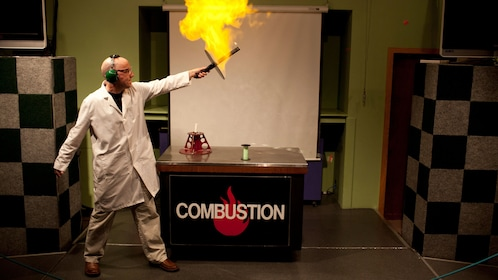 Man playing with fire at a combustion exhibit at Pacific Science Center in Seattle