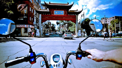 Riding scooters into Chinatown in Montreal