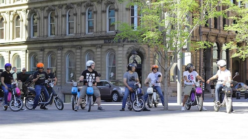 a group of scooter riders in Montreal
