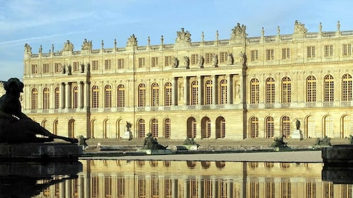 historic building reflecting off of the outdoor pond in Paris