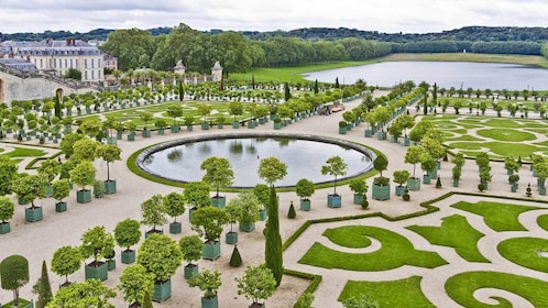 symmetrical garden and pond design outside of Versailles in Paris