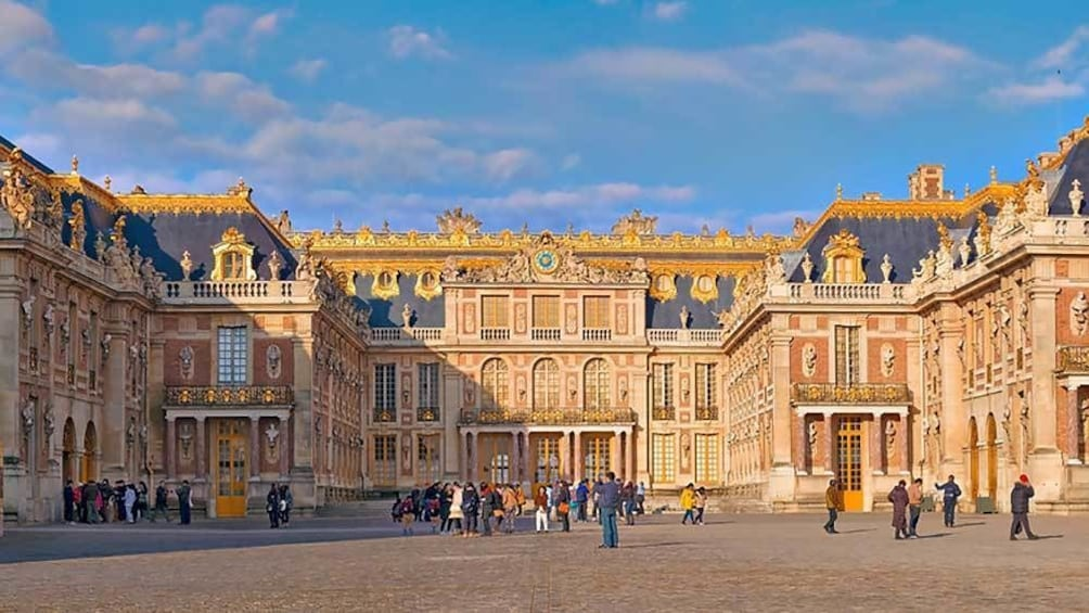Show item 1 of 8. outside at the entrance to Versailles in Paris