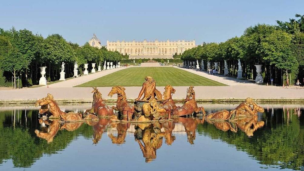 Show item 2 of 8. horse sculptures at the Verailles garden pond in Paris