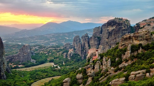 Panoramic view of the rocks and cliffside buildings in Meteora