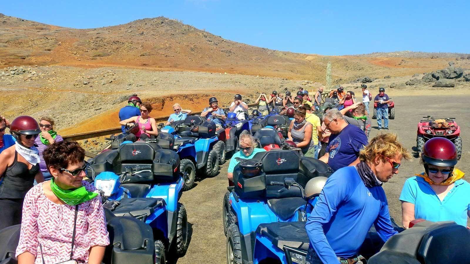 large group of ATV riders gathered in Aruba