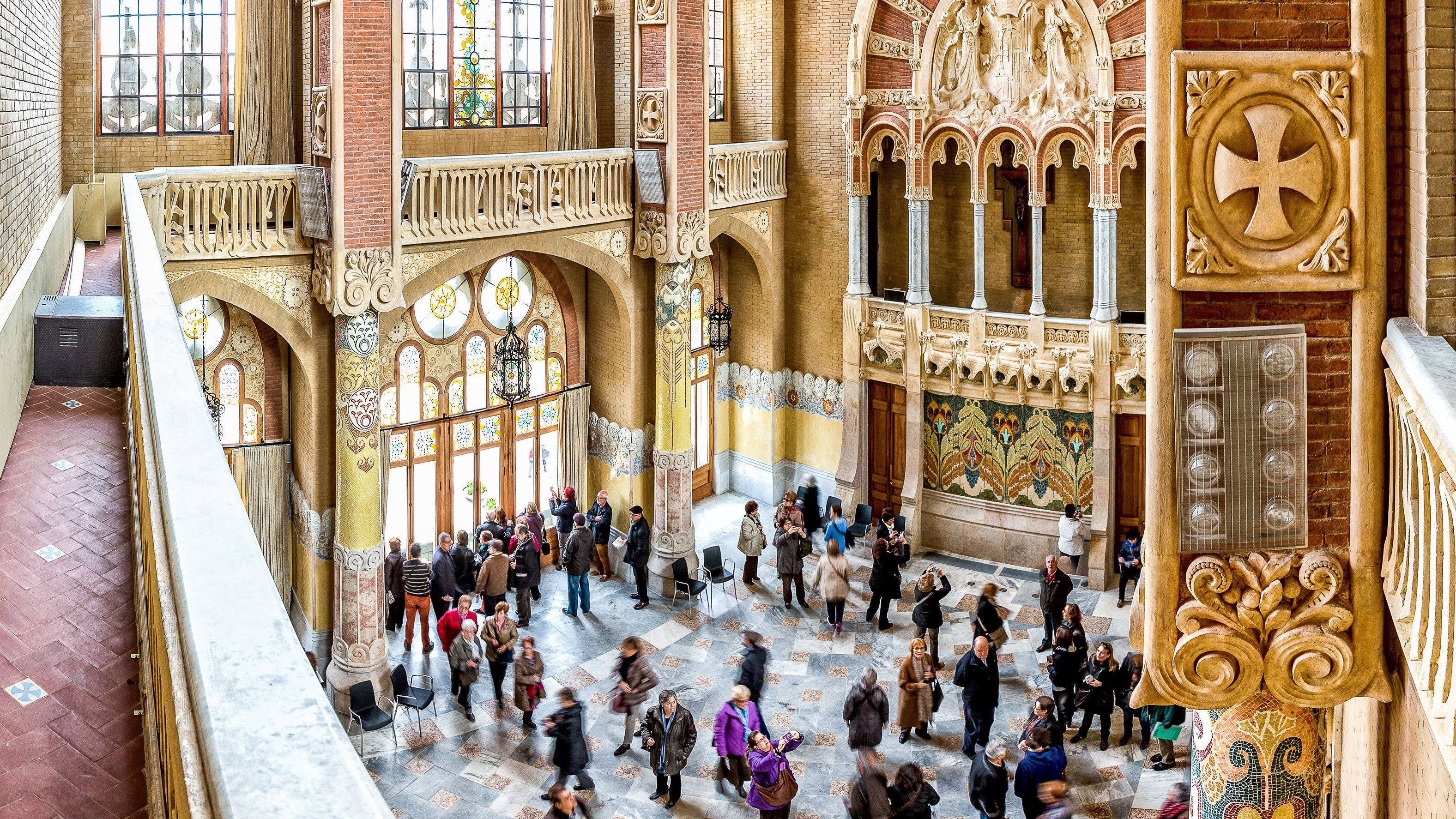 Tourists looking at the beautiful interior of a cathedral in Sant Pau