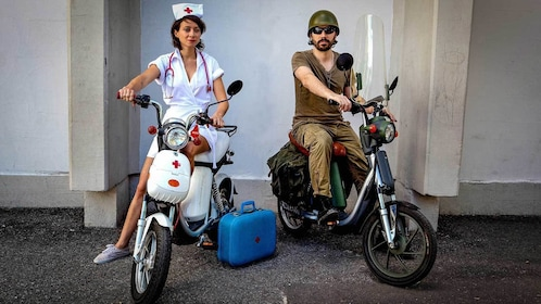 couple in military and nurse costume on scooters in Montreal
