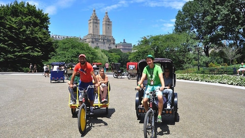 Pedicab drivers transporting couples around Central Park during the day.