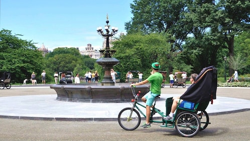 Pedicab driver taking couple around Central Park.