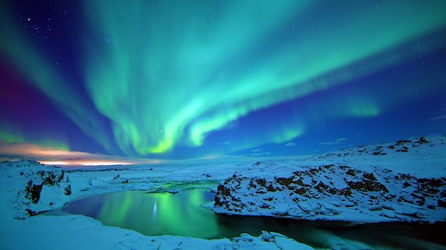 the northern lights reflecting from the a lake in Reykjavik