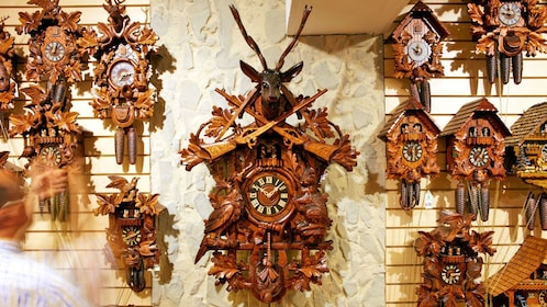 hand carved wooden clocks on display in Switzerland