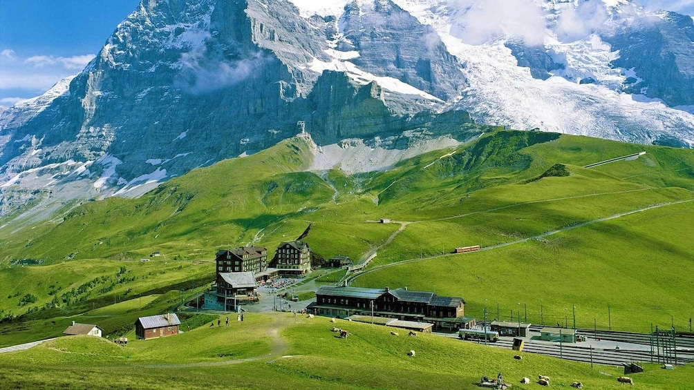 Show item 3 of 8. a bus station in a green valley in Switzerland
