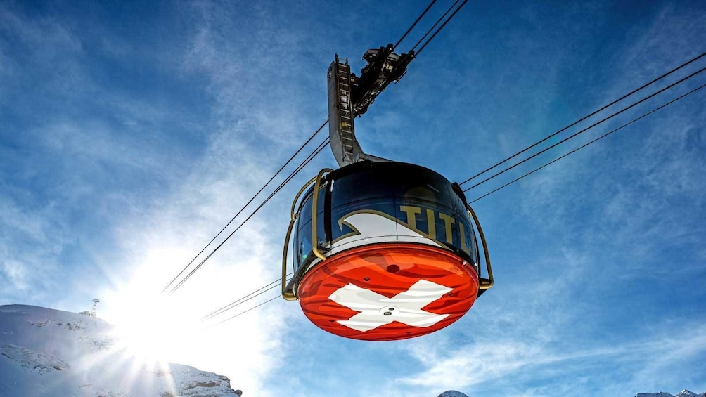 Show item 1 of 9. riding in a round gondola in Switzerland