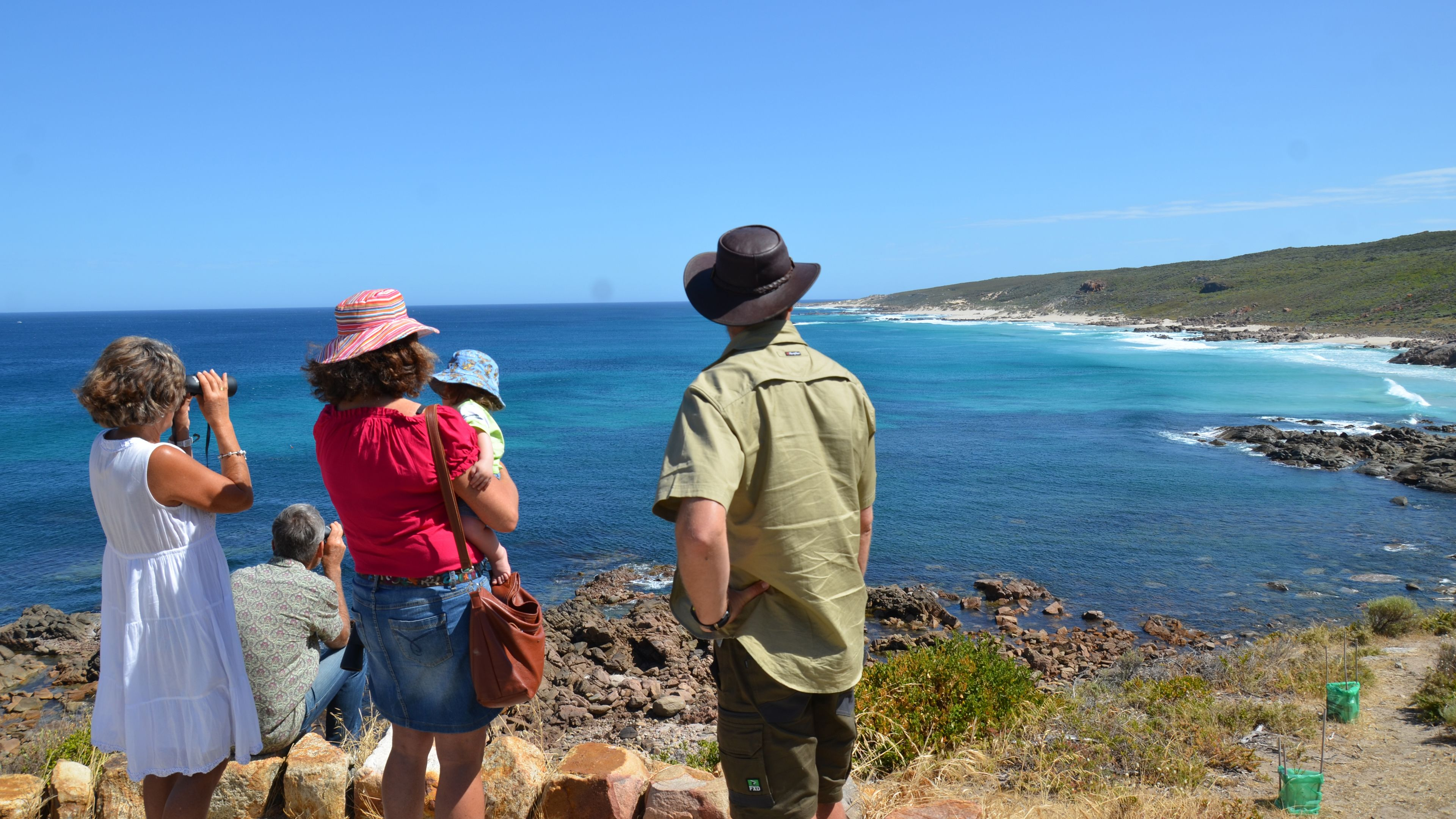family enjoying view of ocean