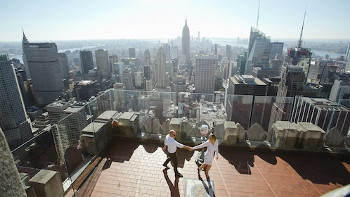 Stunning day view of a photo shoot of a couple at the Top of the Rock in New York