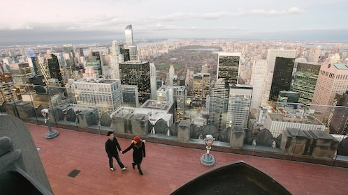 Day view of a Couple on a photo shoot at the top of the rock in New York