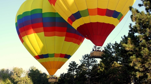 Two hot air balloons ascending in Colorado Springs