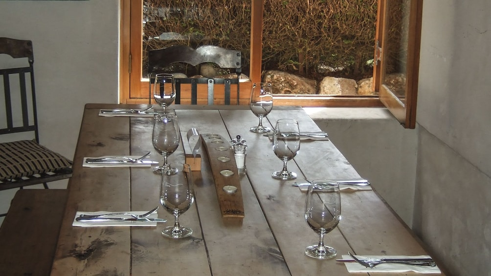 Show item 5 of 5. View of prepared dining table with silverware and wine glasses.