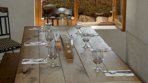 Rustic table and wine glasses at a vineyard in Marlborough