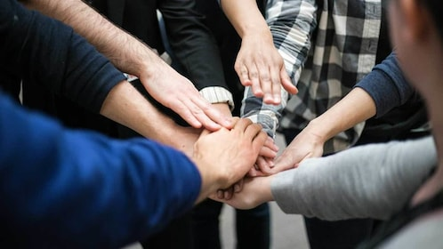 group putting their hands together in New York