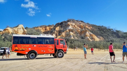 Tour bus and group on the beach on Fraser Island
