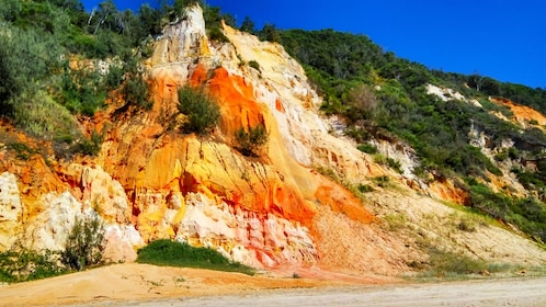 Rocky cliffs and sandy beach at Rainbow Beach on Fraser Island
