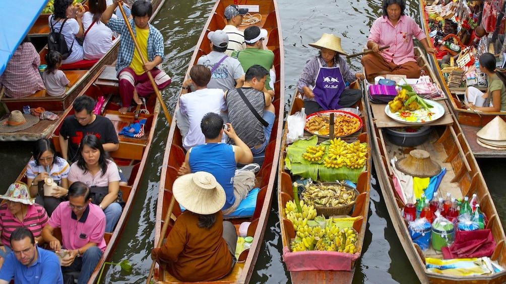 Show item 1 of 6. Vibrant view of the Damnoen Saduak Floating Market in Bangkok, Thailand